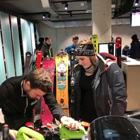 two people are looking at a snowboard