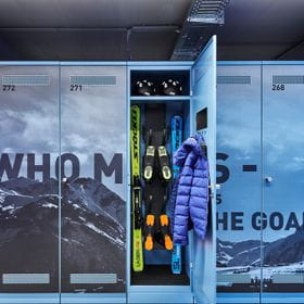 Depot locker which is open and shows some skiing equipment