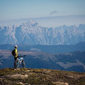 a biker in front of mountains in Zell am See