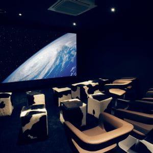 Cinema chairs and screen at Bründl Sports in Kaprun
