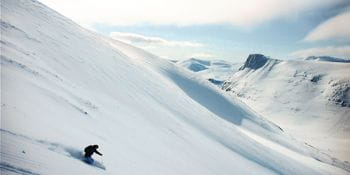 Oliver Dugan skiing down an untracked powder slope