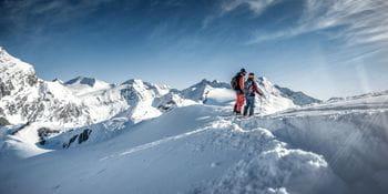 zwei Skifahrer im Tiefschnee auf dem Kitzsteinhorn