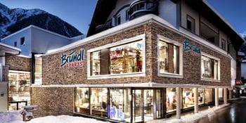 Outside of the Bründl Sports shop in the center of Ischgl at night