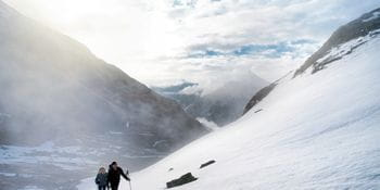 Two people on a ski tour in the mountains