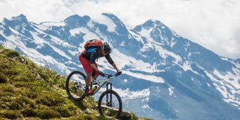 a man is riding down a mountain
