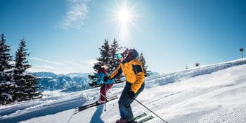 two people are skiing alongside each other