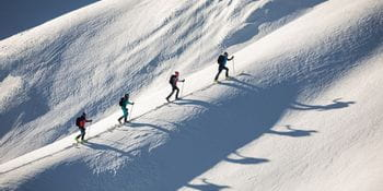 a group of people at a ski tour dressed in martini clothing