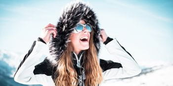 Sparkling young woman with a Sportalm winter jacket