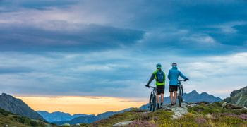 two biker are riding on a mountain in Schladming