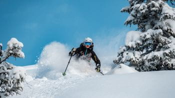 A skier skiing in deep snow