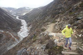 a man running in terrain
