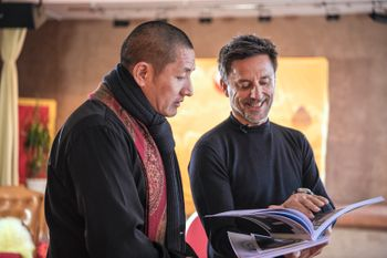 Christoph Bründl and Tulku Lobsang leafing through a book