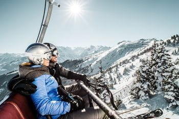 two skier in a chairlift