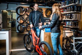 A woman brings her bike for a bike service