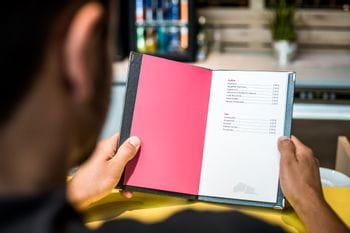 Consumer reading the bar menue at Bründl Sports