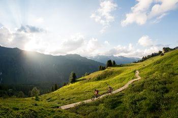 two bikers in a mountainous landscape