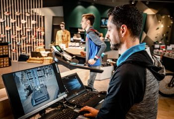 A staff member is doing a treadmill analysis for his client which is running on a treadmill