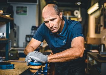 Hans Hofer doing a ski service for racing skis