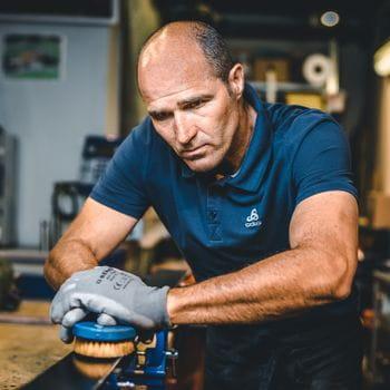 Hans Hofer doing a ski service for racing skis