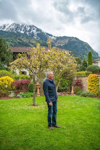 Alois Moreau standing in his backyard