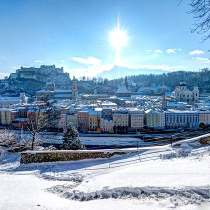 a photo shows the old town of Salzburg in the winter