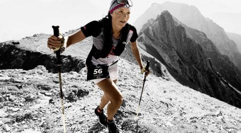 A trail running woman dressed in the dynafit dna collection